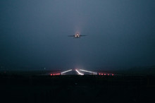 Commercial Jet Departing In The Fog