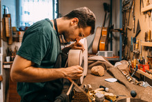 Guitar Maker Working In A Beau...