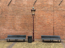 Two Benches And A Brick Wall