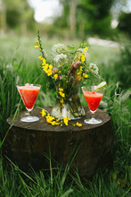 Fresh Red Strawberry Margarita & Flowers On A Wooden Block In The Outdoors