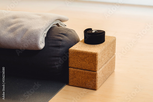 Yoga equipment placed on floor - 336236580