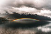 Rainbow Over Calm Lake On Clou...