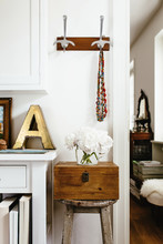 Stylish Interior Corner Decorated With Huge Old Enamel Golden Capital Letter, Flowers In Glass Vase And Painting