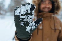 Green Glove With Snow, Close-up