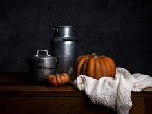 Pumpkin, Tin Cans And Cloth On...
