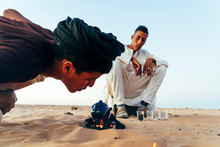 Men Preparing Tea In Sahara De...