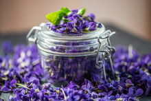 Purple Viola Odorata Violet Flower Heads In A Glass Jar