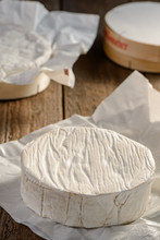 Close Up On A Whole Camembert Cheese Wheel Just From The Box