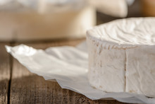 Close Up On Camembert Cheese Wheel On A Wooden Table