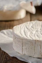 Close View On Camembert Cream Cheese On Wooden Table