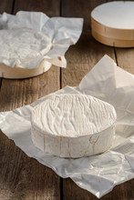 Camembert Cheese Wheel On A Rustic Wooden Table