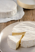 Tasting Of A French Camembert Cheese. Freshly Cut Piece