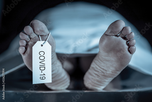 Strong image of feet with toe tag of a dead body coronavirus victim Canvas Print