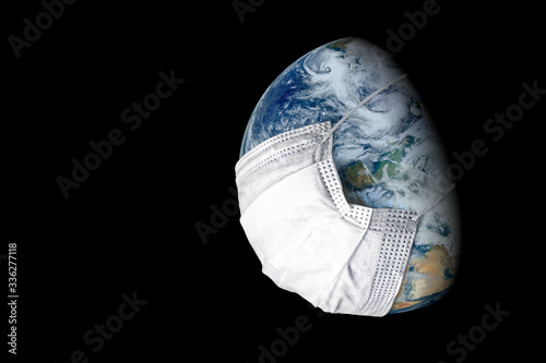Earth in medical mask isolated on black background, concept of coronavirus in world and COVID-19 pandemic Canvas Print