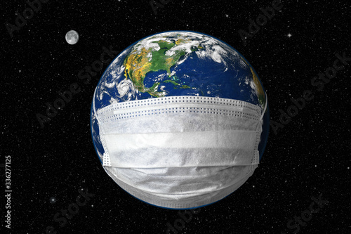 Earth in medical mask on star sky background, concept of coronavirus in world and COVID-19 pandemic Canvas Print