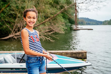 Smiling, Girl Pulling In Boat ...
