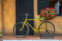 Yellow Vintage Bike With Baske...