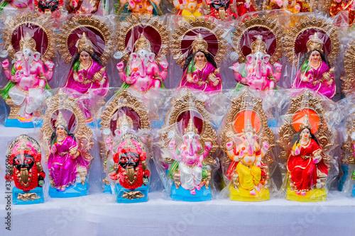 Fotografie, Obraz Idols of Laxmi and Ganesh, India