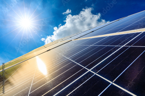 Obraz Photovoltaic solar power panel on sky background,green clean alternative energy concept. - fototapety do salonu