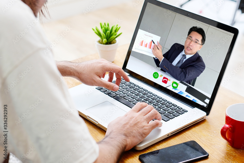 Fototapeta Video conference, Work from home, Businessman making video call to employee with virtual web, Contacting manager by conference on laptop computer at home, Talking on web, Online consultation business