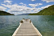 Wooden wharf in the water lake Tarawera New Zealand