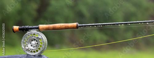 Obraz na plátně Fragment of a fly fishing rod with dew drops