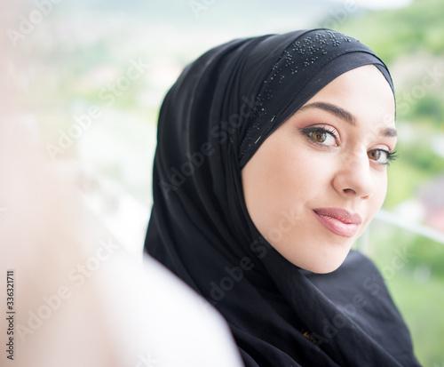 Fotografie, Tablou Beautiful Arabian girl taking selfie