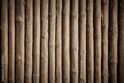 Wall made of wooden logs background. Canvas Print