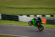 A Panning Image Of A Green Rac...