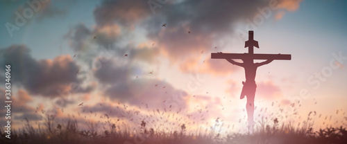 Fototapeta Silhouette Jesus christ death on cross crucifixion on calvary hill in sunset good friday risen in easter day concept for Christian praise for holy spirit religious God, Catholic praying background