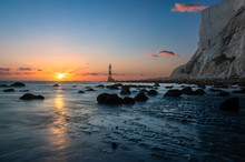 Low Tide At Beachy Head South Downs East Sussex With The Sun Setting Behind The Lighthouse