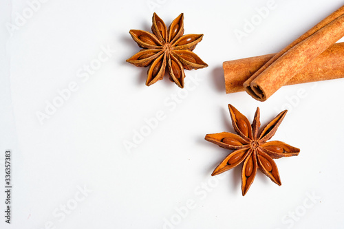 Anise stars, Badian and cinnamon on a white background, space for text,lat lay Canvas Print