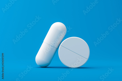 Fotografia White capsule or painkillers with a pharmacy on a medical background