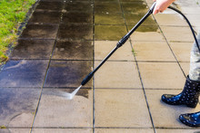 Cleaning Terrace With High-pressure Water Blaster