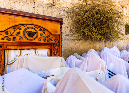 Orthodox Jews wearing tallit prayer shawl for Aaronic blessing, with Aron Kodesh Canvas Print