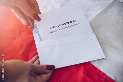 Woman putting correspondence postal ballot paper to envelope. Canvas