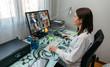 Leinwandbild Motiv Woman having a video conference work meeting from home