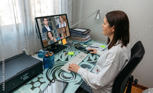 Woman having a video conference work meeting from home