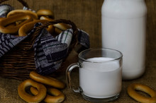 Bagels In A Basket And A Glass Of Milk On A Background Of Burlap