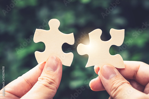 Partnership with puzzle jigsaw perfect fit match teamwork support build dream team Fototapete