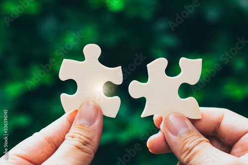 Tablou Canvas Partnership with puzzle jigsaw perfect fit match teamwork support build dream team