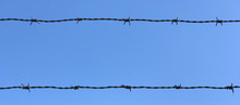 Barb Wire Fence With Blue Sky ...