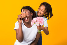 Black Girl Congratulating Her Mom With Flowers