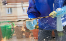 Housekeeping: Cleaning The Windows, Window Cleaner Using A Squeegee, Sponge And Soap Suds To Wash A Window