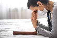 Woman With Mask Praying Next T...