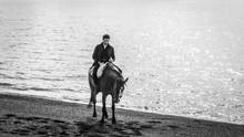 Man Horse Riding In Patagonia