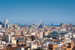 View at Valencia cityscape with sea port in distance. Downtown with rooftops of residential dwellings. Valencia downtown. Spain. Europe.