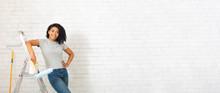 Homemade Design. African American Woman On Stepladder