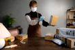 A person spraying disinfectant on parcels and boxs during coronavirus Covid-19 pandemic