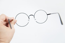 Hand Holds Glasses. Isolated O...